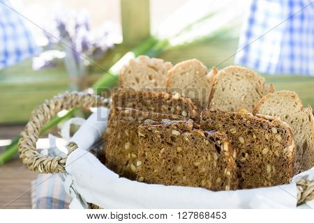 Varied bread cut to slices close to a window