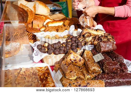 Market stalls with baked goods. Spring Fair on the Square