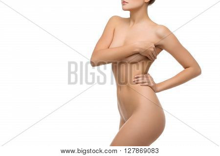 Beautiful naked fit young woman body. Isolated over white background. Copy space.