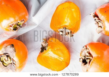 Fresh Juicy Persimmons On A Light Background, Raw Fruit