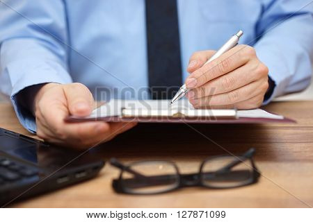 Manager reading report concept of accountingreport and leadership
