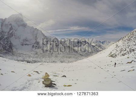 Snow peak, stone pyramid for saftey of climbers and trekkers, buddhism tradition in Himalaya