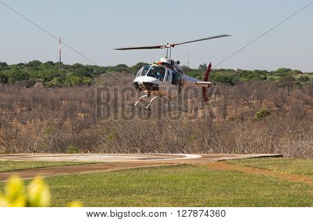 Helicopter landing at Victoria Falls. Zimbabwe Africa.