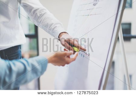 Business meeting office.Photo man showing statistics info chart board.Photo account managers crew working with new startup project.Idea presentation, analyze marketing plan. Film effect, horizontal