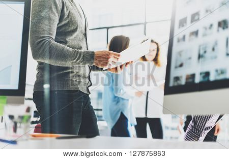 Business meeting office.Photo businessman holding documents hands. Photo account managers crew working with new startup project.Idea presentation, analyze marketing plan.Blurred, film effect.
