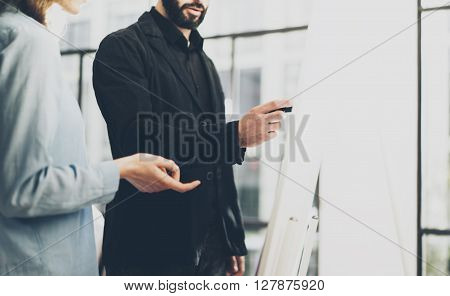 Business meeting office.Closeup photo men writing statistic info chart board.Photo account manager crew working with new startup project.Idea presentation, analyze marketing plan.Blurred, film