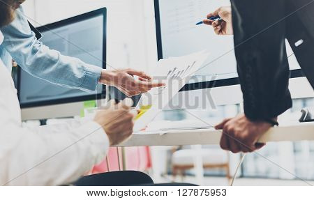 Business meeting brainstorming, documents holding hands. Photo account managers crew working with new startup project.Idea presentation, analyze marketing plans.Blurred, film effect