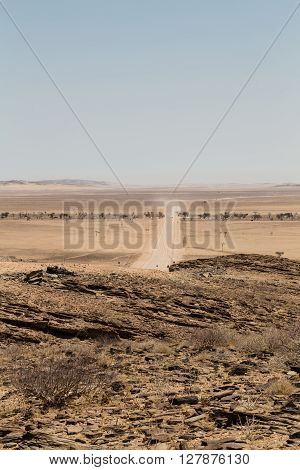 Lonely road in the desert of Namibia. Travelng into the unknown. Africa.