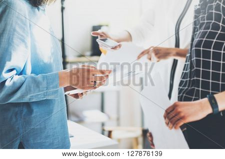 Business women meeting.Closeup photo documents holding hands. Photo marketing managers working with new startup project. Idea presentation, analyze market reports.Blurred, film effect.