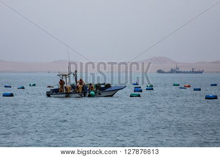 Oyster fishing on boat at Walvis bay Namibia.