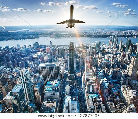 picture of a airplane over the skyline of new york