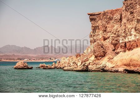 Beautiful Cliffs On Coast Of The Blue Clear Sea