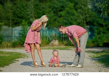 photo of young family parenting naughty son