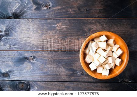 Bowl of raw tofu cubes. Copy space. Menu page
