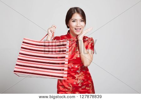 Asian Girl In Chinese Cheongsam Dress With Shopping Bag