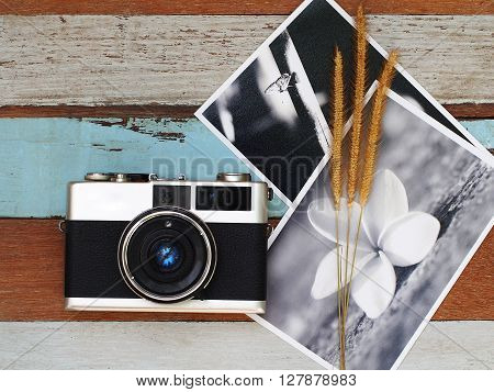 Vintage old camera with picture on the old wooden