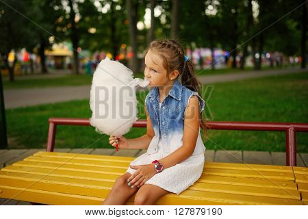 photo of cute little girl with cotton candy in park ** Note: Soft Focus at 100%, best at smaller sizes
