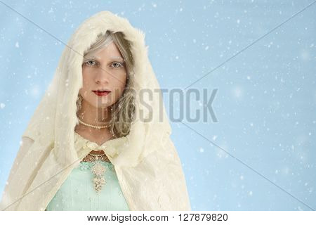 portrait of woman with cloak in the snow