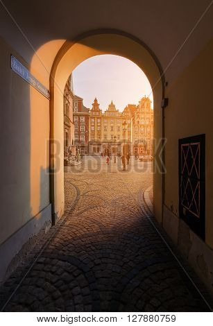 View from under the arch on market square during sunset in Wroclaw Poland