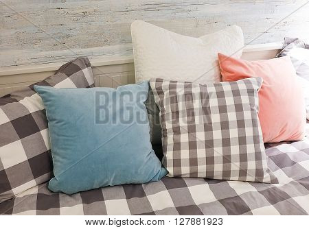 Wooden White Cozy Sofa with Five Decorative Pillows.
