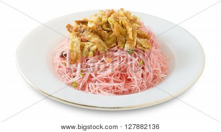 Thai Cuisine and Food Plate of Red Stir Fried Rice Vermicelli Served with Julienne Omelet and Chopped Scallion Isolated on White Background.