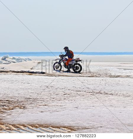 Berdsk Novosibirsk oblast Siberia Ob river Russia - April 17 2016 - motorcyclists ride on the river ice