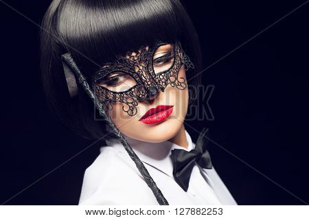 Sexy woman with whip and mask bdsm