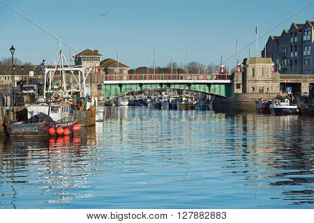 Weymouth, UK - April, 17, 2016. Weymouth Town Bridge, a 1930 swing bridge in Weymouth Harbour, Dorset a fishing harbour and popular holiday resort.