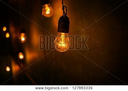Incandescent lamps in a modern studio. Cool Edison lamp.