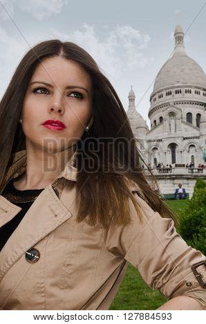 Sexy woman portrait in coat in front of Sacre Couer, Montmartre, Paris.