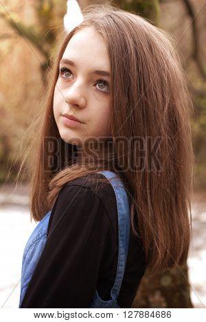 Pretty teenage girl looking upwards looking sad