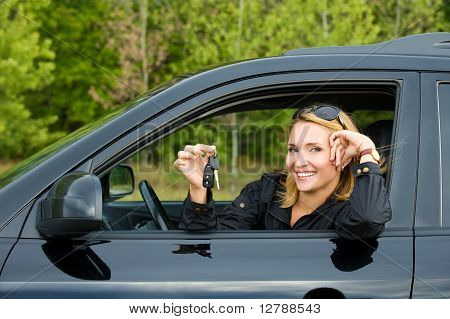 Cheerful Woman With Keys Of Car