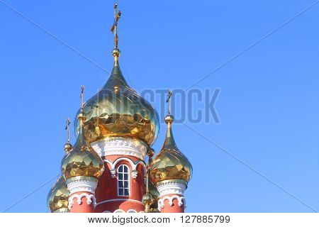 Golden domes with crosses of russian christian orthodox church
