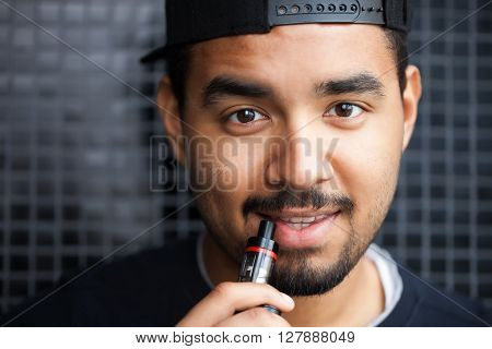 Young Black Hip Hop Guy Smoking E-cig Vaporizer