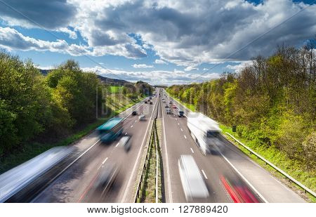 Vehicles in Motion on Busy Rural Motorway