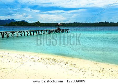 Beach And Wooden Dock On Bolilanga Island. Togean Islands. Indonesia.