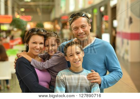 Portrait of a happy family  walking in city