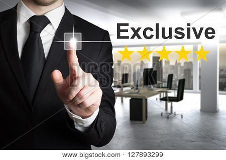 businessman in office pushing touchscreen button exclusive gold stars