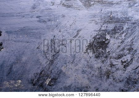 Blue Grunge background with paint brush marks and scratches.