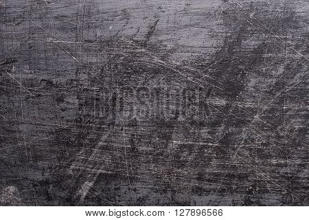 Black Grunge background with paint brush marks and scratches.
