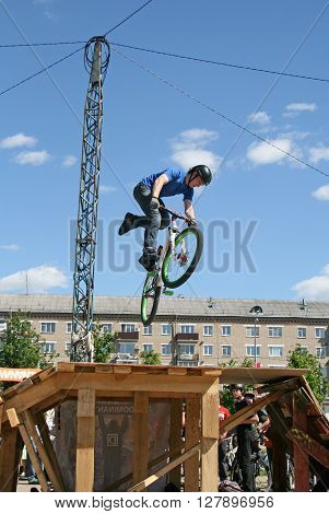 MOSCOW REGION SERGIYEV POSAD RUSSIA - MAY 31 2009: BMX biker performing in local BMX competition