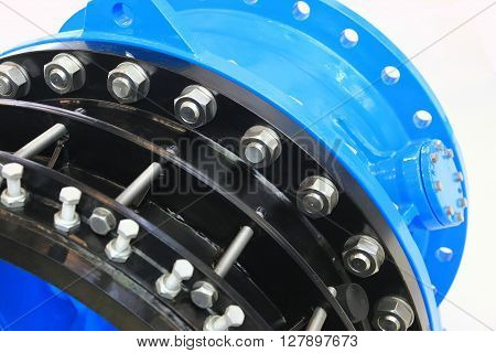 The flanges of valves with bolts and nuts. Connecting fittings of different diameters.