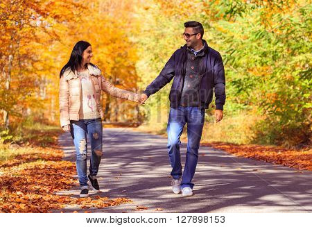 Happy Young Couple At First Date Taking A Walk