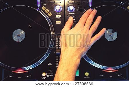 Deejay Scratching On Two Music Players