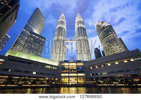 Kuala Lumpur, Malaysia - May 6, 2014: View of famous Petronas Towers lit up at twilight in Kuala Lumpur, Malaysia.
