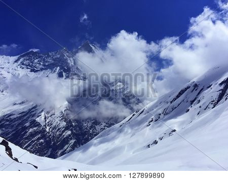 Panorama of snow mountains near Annapurna, summer day in Himalayas, Himalayan peaks under sun, summer snow, trekking to Annapurna, cold summer, snow trekking path, peaks of Himalaya, Nepal