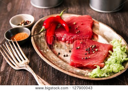 Tuna Steak On A Plate With Chili Peppers