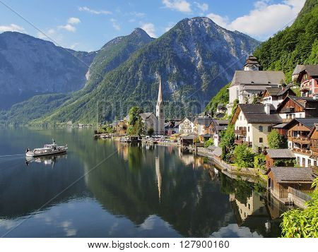 Hallstatt classic view Scenic panoramic picture-postcard view of famous Hallstatt mountain village with Hallstatt lake in the Austrian Alps. Beautiful village among Mountains peaks morning