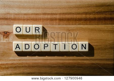 Image of an adoption announcement on wood