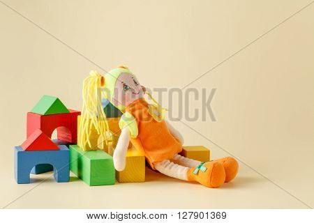 Baby Play Concept, Cloth Doll And Wooden Blocks
